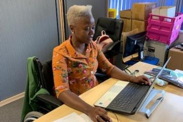Volunteer named Charlene working at computer
